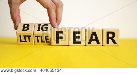 Little Or Big Fear Symbol. Hand Turns Wooden Cubes And Changes Words 'little Fear' To 'big Fear'. Be