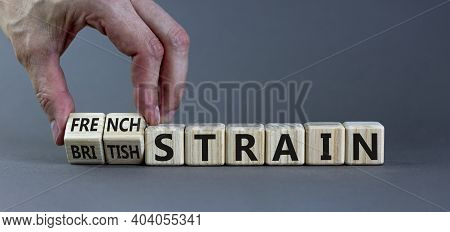 Covid-19 British And French Strain Symbol. Hand Turns Cubes And Changes Words 'british Strain' To Fr