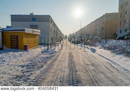 Pruszcz Gdanski, Poland - January 17, 2021: Street Covered By Snow At Sunny Winter Day In Poland.