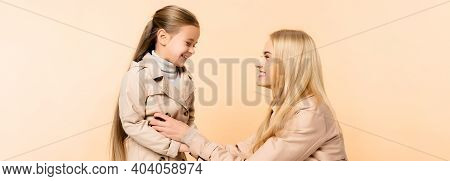Cheerful Blonde Mother Tickling Happy Daughter Isolated On Beige, Banner