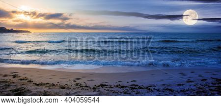 Day And Night Time Change Concept At The Seaside In Summer. Beautiful Seascape With Sun And Moon. Ca