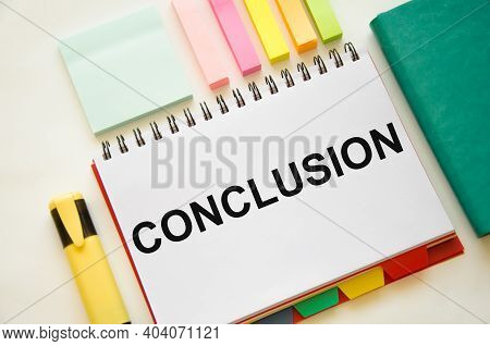 The Word Conclusion Is Written On White Notepad And White Background Near Markers And Notepad