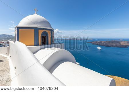 Sunny Blue Sky Belltower Of A Church With A View Of Santorini Volcanic Caldera And Ships In It, Sant