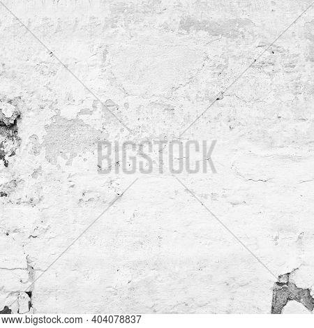 Old White Weathered Stucco Texture. Aged Paint Brick Wall Background. Grunge Blocks Stonework Brickw