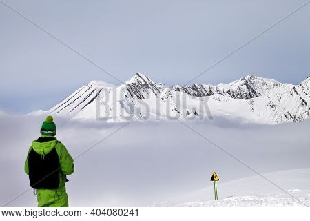 Freerider On Snowy Off-piste Slope In Mist And Warning Sing. Caucasus Mountains In Winter, Georgia,