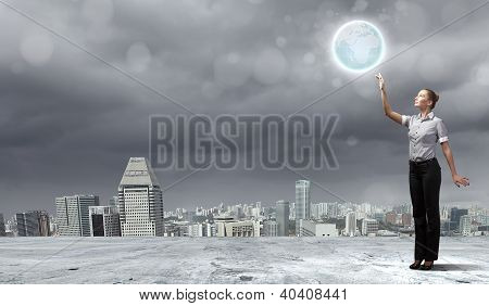 Businesswoman holding the world
