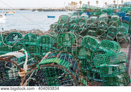 Ropes, Nets And Handcrafted Fishing Traps For The Octopus, Lobsters And Crabs In The Fishing Port Of