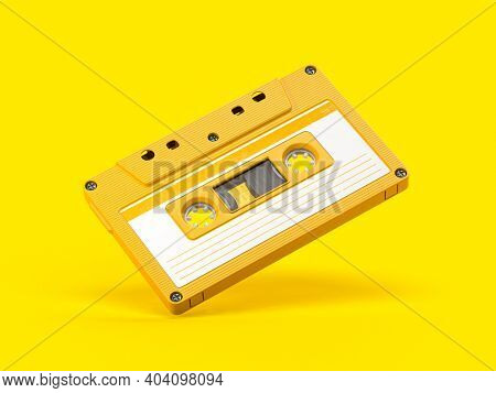 Yellow vintage audio cassette on yellow background. 3d illustration