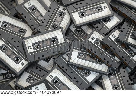 Heap of vintage audio cassettes. Retro music concept background. 3d illustration