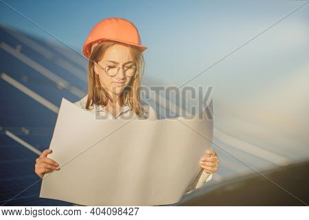 Handsome Architect Woman Examining A Draft Map Or Blueprint Project Plan, Worker Activity Looking Ou