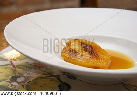Dessert Of Pear Brulee With Dolce Gorgonzola Cheese