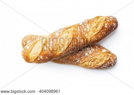 Two crispy fresh baguettes isolated on a white background.