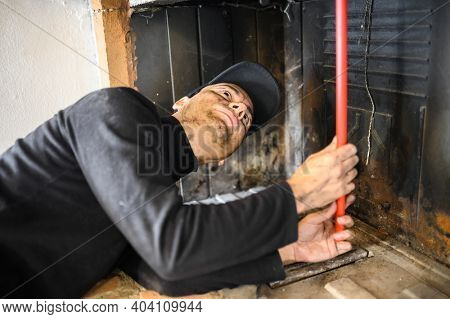Young chimney sweep at work