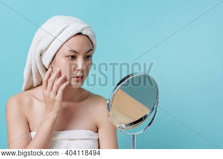 Beautiful Asian Young Woman Touching Face While Looking Facial Skin Is Restoring At The Mirror Waiti