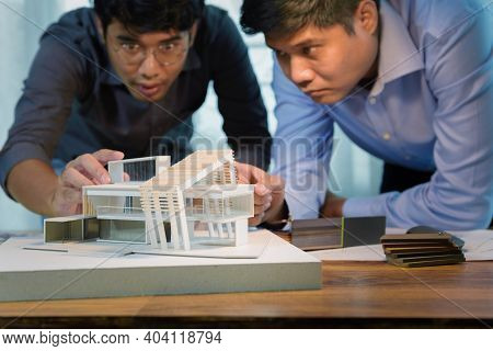 Two Asian Architects Discussing With Designer Or Civil Engineer About Concept Of Building Design And