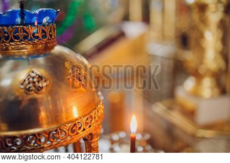 Lighting Candles In A Catholic Temple . Candles Are Lit Near The Altar In A Catholic Temple.
