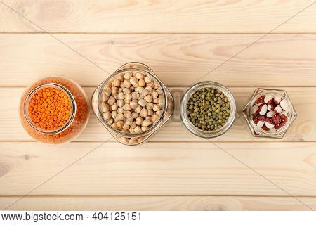 Food Storage. Food Ingredients In Glass Jars And Tins On Wooden Table Top View, Copy Space. Preserva