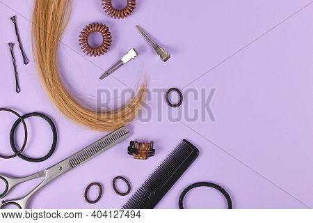 Hair Styling Concept With Dark Blond Hair, Elastic Hair Ties, Hair Pins, Comb And Thinning Shears On