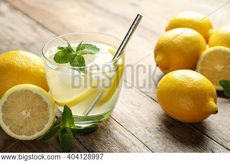 Natural Lemonade With Mint And Fresh Fruits On Wooden Table, Closeup. Summer Refreshing Drink
