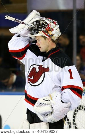 NEW YORK-APR 27: New Jersey Devils goalie Johan Hedberg (1) guards the net against the New York Rangers during the secdond period at Madison Square Garden on April 27, 2013 in New York City.