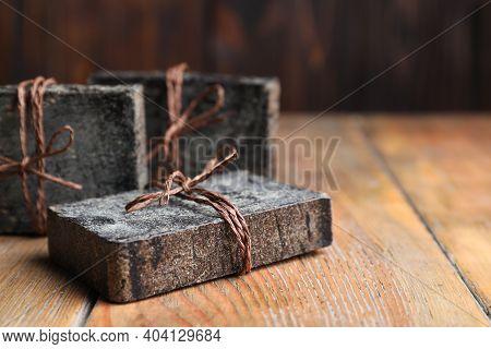 Natural Tar Soap On Wooden Table, Closeup