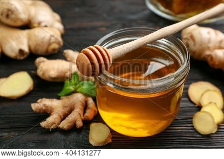 Honey And Ginger On Black Wooden Table, Closeup. Natural Cold Remedies