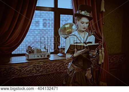 Beautiful steampunk lady scientist stands in her laboratory and reads a book. Victorian vintage interior.