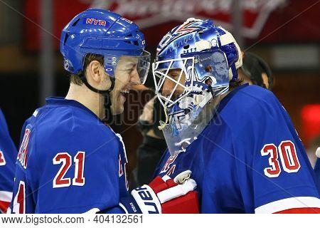 NEW YORK-APR 27: New York Rangers center Derek Stepan (21) and goalie Henrik Lundqvist (30) celebrate against the New Jersey Devils at Madison Square Garden on April 27, 2013 in New York City.