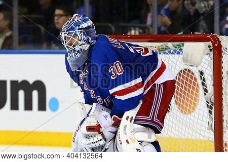NEW YORK-APR 27: New York Rangers goalie Henrik Lundqvist (30) guards the goal against the New Jersey Devils at Madison Square Garden on April 27, 2013 in New York City.