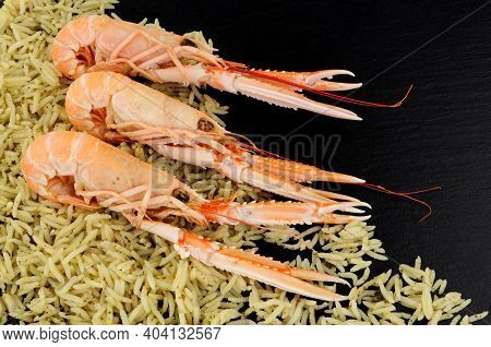 Freshly Cooked Whole Dublin Bay Prawns Also Known As Langoustine And Scampi With Rice On A Slate Sto
