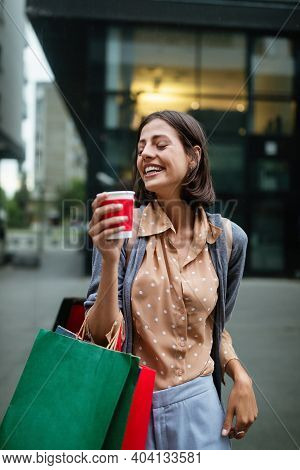 Happy Woman With Shopping Bags Enjoying In Shopping. Consumerism, Shopping, Lifestyle Concept