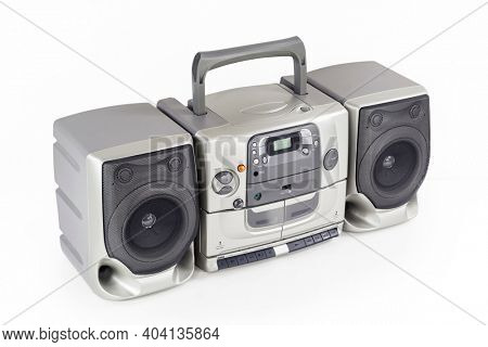 Big boom box vintage portable stereo radio, cd, cassette tape player and recorder on white.