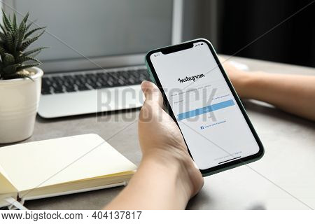 Mykolaiv, Ukraine - July 9, 2020: Woman Holding Iphone 11 With Instagram App On Screen At Table, Clo