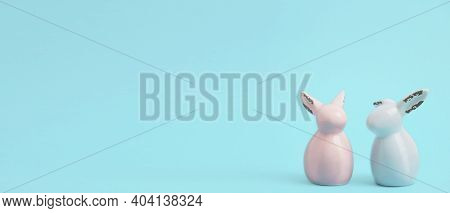 Easter Banner. Rabbits On Blue Pastel Background With Space For Text. Mokeup Wit Pastel And Colorful