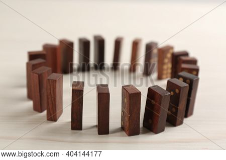 Wooden Domino Tiles With Golden Pips On White Table