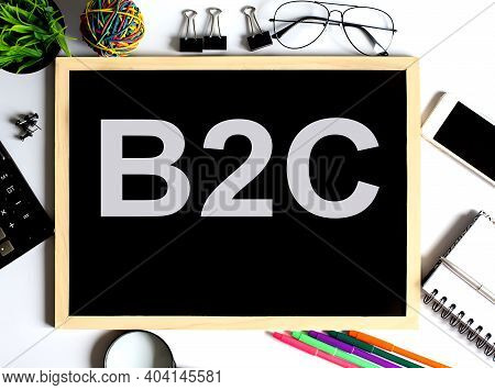 B2c Concept On Drawing Board With Office Tools