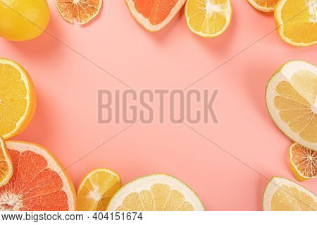 Fresh Citrus Fruit Assortment. Different Citrus Fruit On Pink Background. Fruit Food Frame Border. B