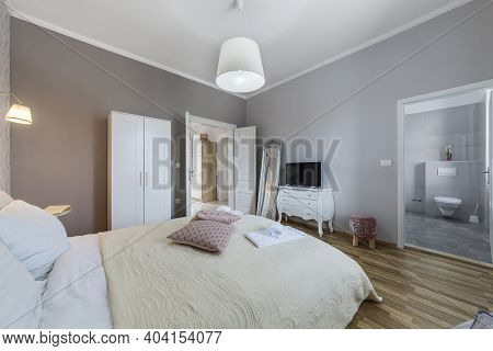 Interior Of  The Modern Bedroom Apartment, Bathroom In Backgroud