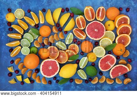 Winter sunshine citrus fruit collection with cranberries, blueberries, oranges, lemons, limes an grapefruit high in antioxidants, anthocyanins, fibre and vitamin c. For immune system boost.