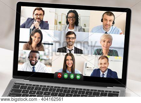 Closeup Of Laptop Computer Screen With Business People Having Online Meeting Via Video Call Indoor.