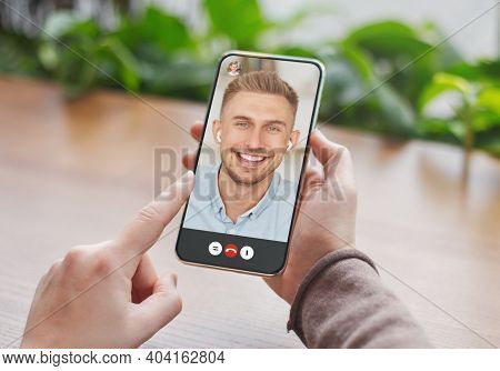 Unrecognizable Young Woman Having Video Call With Her Boyfriend, Using Online Messenger On Smartphon