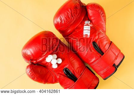 Ampoule And Pills On Boxing Gloves, Top View. Foul Fight Concept. Doping For The Athlete.