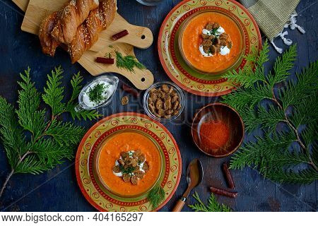 Top View Of Tomato Soup With Baked Peppers And Tomatoes On Beautiful Plates With Croutons And Sour C