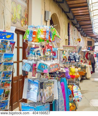 Paphos, Cyprus - February 16, 2019: Colorful Gifts Magnets, Kitchen Towels On Stands At Souvenir Mar