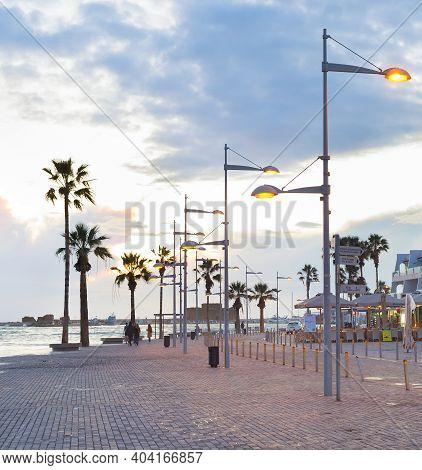 Paphos, Cyprus - February 15, 2019: Touristic Downtown Embankment With Souvenir Shops And Cafes, Car