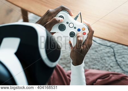 African man playing a game with gaming controller