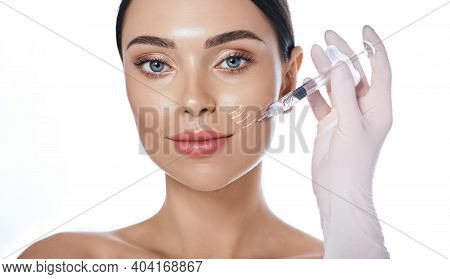 Beautician Doing Injection Into The Nasolabial Folds. Correction Of Wrinkles On The Female Face Usin