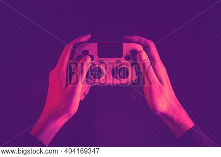 Hand playing video game using a game console entertainment technology