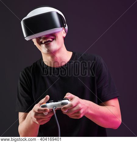 Man playing game with VR headset and controller virtual reality experience