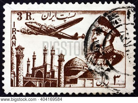Iran - Circa 1953: A Stamp Printed In Iran Shows Plane Above Mosque, And Mohammad Reza Shah Pahlavi,